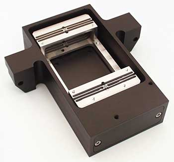 Flexure-guided voice-coil motor-driven positioning and scanning stage.