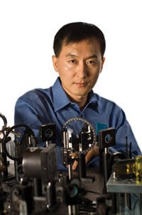 Dr. Chunlei Guo of the University of Rochester stands in front of his femtosecond laser.