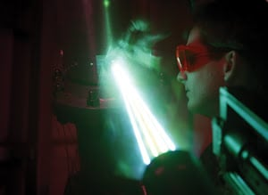 In 1997, an engineer at the Marshall Space Flight Center (MSFC) Wind Tunnel Facility uses lasers to measure the velocity and gradient distortion across an 8-in. curved pipe with joints and turning valves during a cold-flow propulsion research test, simulating the conditions found in the X-33's hydrogen feedline.