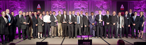Winners of the 2012 Prism Awards for photonics innovation pose with presenters after the gala awards banquet in January 2012 at the Hilton San Francisco Union Square during SPIE Photonics West.