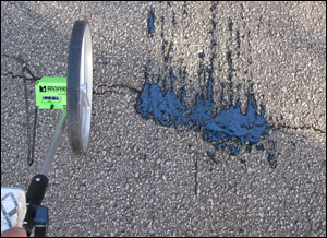 Example of a pavement crack filled with GTRI's prototype automated pavement crack detection and sealing system.