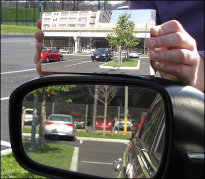 A side-by-side comparison of a standard flat driver's side mirror with the mirror designed by Dr. R. Andrew Hicks, a mathematics professor at Drexel University.