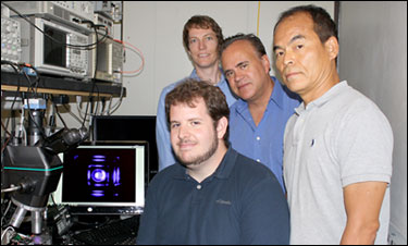 Shuji Nakamura and his research group at UCSB demonstrate the first violet nonpolar m-plane VCSEL based on gallium nitride. Pictured, from left, Casey Holder, Daniel Feezell (back), Steven DenBaars, Shuji Nakamura.