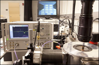 The experimental setup in Donhee Ham's lab, shown here, tests the new metamaterials, which are fabricated on tiny chips.