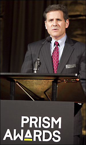 Mike Cumbo speaking at the Prism Awards ceremony in January 2012.