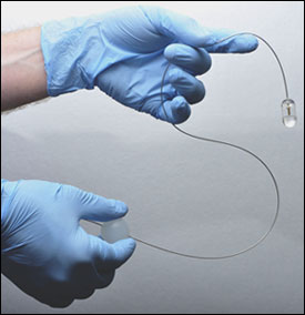 By manipulating the plastic ball attached to the flexible tether (lower, right hand) the system operator can control the position of the endomicroscopy capsule in a patient's esophagus.