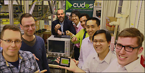 The CUDOS research team at the University of Sydney: (Left to right) Dr. Alex Clark, Michael Steel, professor Benjamin Eggleton, Jiakun He, Shayan Shahnia, Dr. Chunle Xiong, Trung Vo and Matthew Collins.