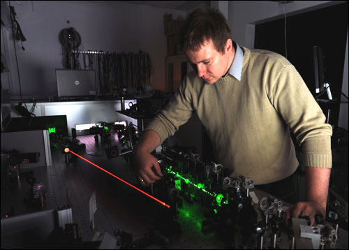 A new parametric amplifier developed in the Laser Centre of the Institute of Physical Chemistry of the Polish Academy of Sciences in Warsaw and the Faculty of Physics of Warsaw University allows the construction of desktop-sized laser setups capable of generating femtosecond laser pulses with a power of tens of terawatts. Pictured is Dr. Pawel Wnuk from the Laser Centre at the new amplifier.