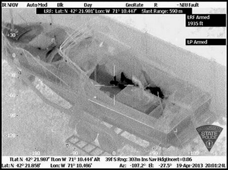 The feet of Boston Marathon bombing suspect Dzhokhar Tsarnaev are clearly visible in this infrared imaging shot from a Massachusetts State Police video.