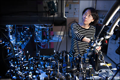 Physicist Na Young Kim, at the optical bench, is a member of the international team that has demonstrated a revolutionary electrically driven polariton laser that could significantly improve the efficiency of lasers.
