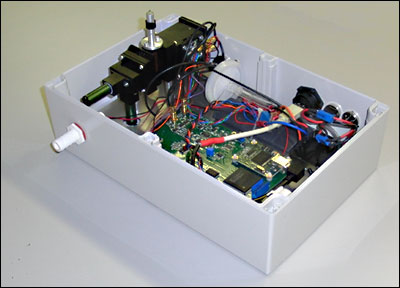 A prototype asbestos detector unit with the lid removed.