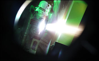 During a recent experiment at Los Alamos National Laboratory's Trident laser facility, a burst of laser energy 50 times greater than the worldwide output of electrical power slams into an extremely thin foil target, producing neutrons and proving that laser-driven neutrons can be used to detect and interdict smuggled nuclear materials.