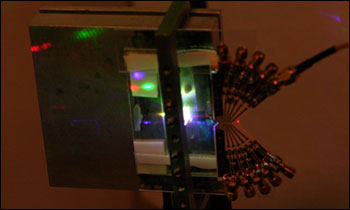 Anisotropic leaky-mode modulator for creating holographic video images.