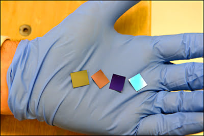 These four wafers contain the thinnest light-absorber layer ever built.