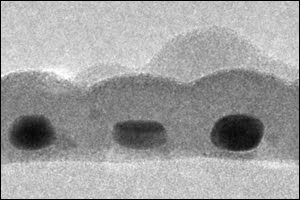 This is a cross section of the record-thin absorber layer showing three gold nanodots, each about 14 × 17 nm in size and coated with tin sulfide.