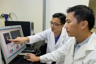Zhang Qichun and Joachim Loo study the differences between the new biomarker and conventional ones.