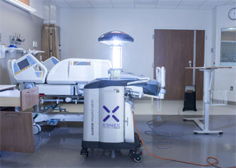 A Xenex Germ-Zapping Robot disinfects a hospital room.