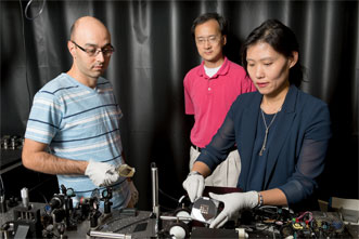 From left, graduate student Mohammad Parvinnezhad Hokmabadi, Dr. Patrick Kung and Dr. Seongsin Margaret Kim work with the terahertz metamaterial.