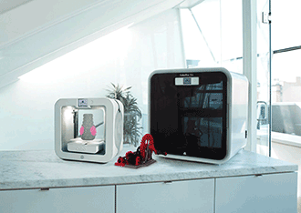 The new Cube 3D printer and the CubePro Duo 3D personal printer, both from 3D Systems.