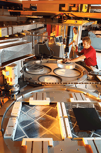 Polishing large optical flats as part of the fabrication process.