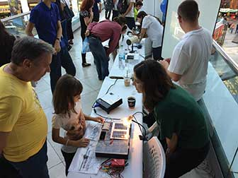 A young visitor at the Center for Science Education and Training (CSET) at the National Institute for Laser, Plasma and Radiation Physics, examines a newly introduced teaching kit about photovoltaic energy at the Researchers' Night 2015 in Bucharest, Romania.
