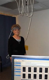 A study participant stands while wearing the portable functional near-infrared (fNIR) spectroscopy system, which uses light to monitor changes in blood oxygenation in the brain as individuals perform tasks.