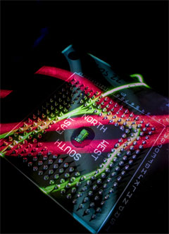 The electronic-photonic processor chip communicates directly with other devices using light.