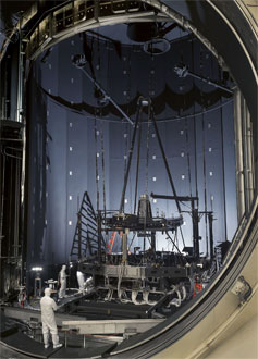 Engineers inspect the Pathfinder telescope after its second super-cold optical test at NASA's Johnson Space Center in Houston.