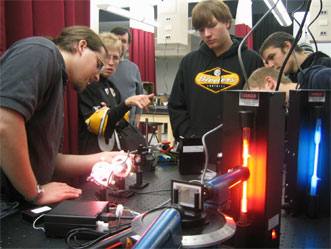 Students with HeNe laser