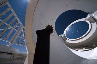 A starshade is shown positioned in front of the heliostat mirror of the McMath-Pierce Solar Telescope in Arizona to test its performance against celestial objects.