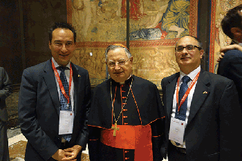 EPIC's Carlos Lee, left, Cardinal Giuseppe Bertello and Antonio Raspa of Quanta System, which donated several laser systems for use in the cultural heritage projects.