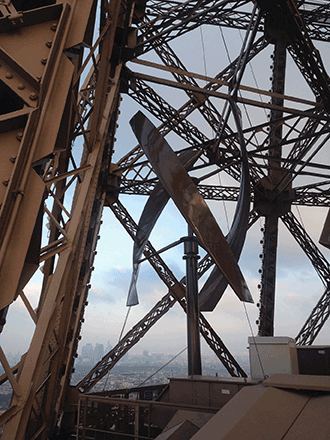 Part of a clean-source energy system designed by UGE International, LED lighting and roof-mounted solar panels are sharing space with two vertical-axis wind turbines that have been installed on the Eiffel Tower.
