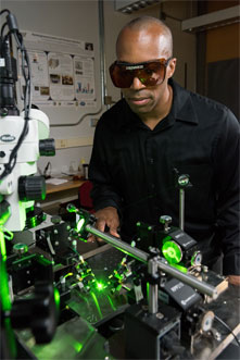 Georgia Tech associate professor Baratunde Cola measures the power produced by converting green laser illumination to electricity using the carbon nanotube optical rectenna.