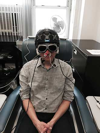 Participants in this VA LED treatment study wear an LED helmet, intranasal diodes and LED cluster heads placed on the ears.