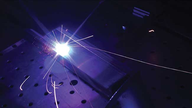 The structured material appears at the left of the laser beam.