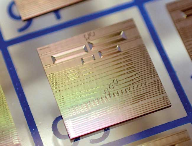 prototype SiN photonics integrated circuit fabricated at Ligentec (Lausanne, Switzerland)is one example of a better, smaller, faster chip that will introduce economies of scale in future telecom and datacom build-outs.