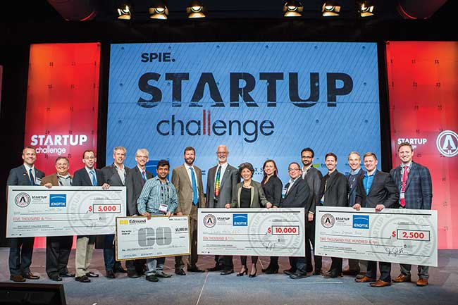 Winners and judges show some of the prizes awarded in the 2016 SPIE Startup Challenge.