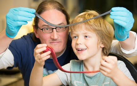 Professor Jonathan Coleman and his son, Oisin, with G-putty and silly putty.