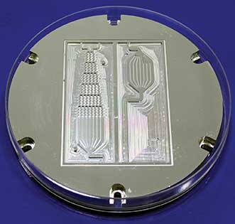 Mold insert for microfluidic components.