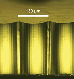A microscopic picture of a cylindrical micromirror array from diamond shaping
