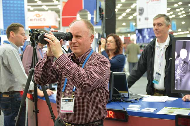 An attendee checks out new equipment at the 2015 show.