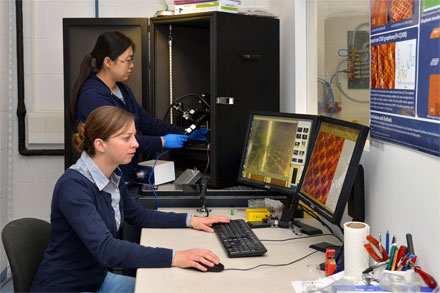 Sarah Wieghold and Juan Li at the scanning tunneling microscope where the photoresponsive monolayers were characterized.