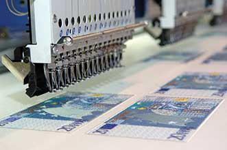 In some instances, such as for the security features on currency, UV or infrared light is used as part of the inspection process.