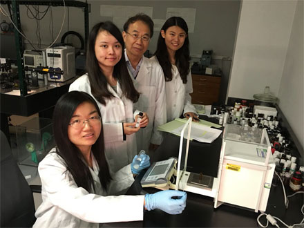 Professor Shin-Tson Wu and doctoral students work on liquid crystal mixtures in his lab at the University of Central Florida's College of Optics & Photonics.