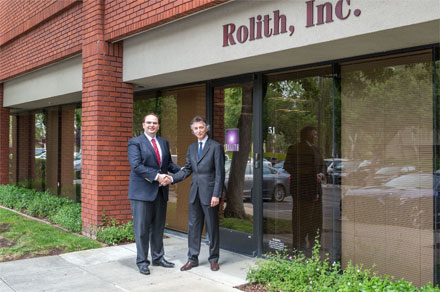 George Palikaras, founder and CEO of MTI (left) shaking hands with Boris Kobrin, founder and CEO of Rolith Inc.