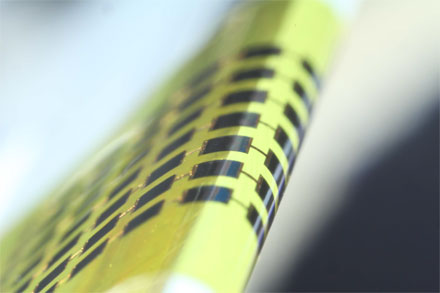 Ultra-thin solar cells are flexible enough to bend around small objects, such as the 1mm-thick edge of a glass slide, as shown here.