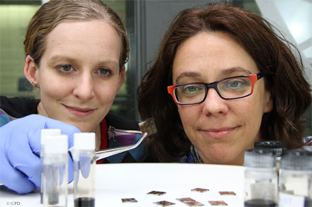 Researchers Nicky Miller and Maria Bernechea hold a semitransparent solar cell.