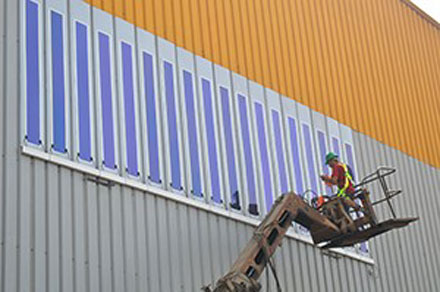 Installation of HeliaFilm on Kandil Steel panels.