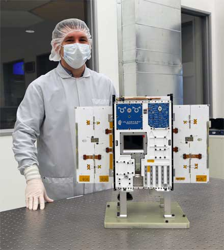 Planetary Resources' president and CEO Chris Lewicki with the Arkyd 6 spacecraft before delivery to the launch pad.