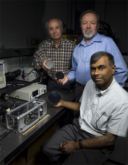 John Kolasinski (left), Ted Kostiuk (center), and Tilak Hewagama (right) hold mirrors made of carbon nanotubes in an epoxy resin.